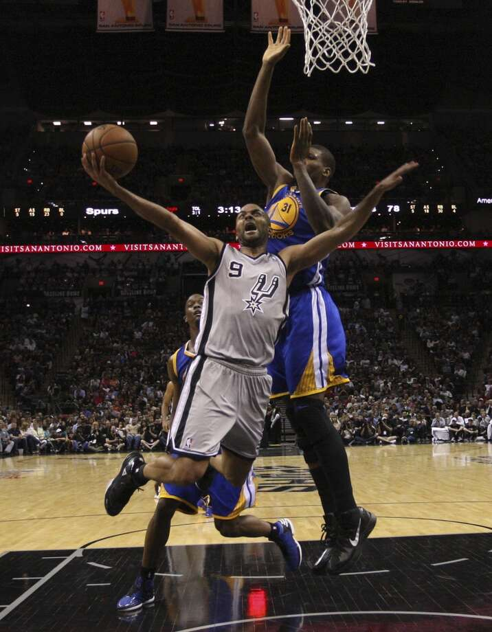 San Antonio Spurs' Tony Parker drives as Golden State Warriors' Festus Ezeli defends during  second half of Game 1 in the NBA Western Conference semifinals at the AT&T Center, Monday, May 6, 2013. The Spurs won in double overtime 129-127.