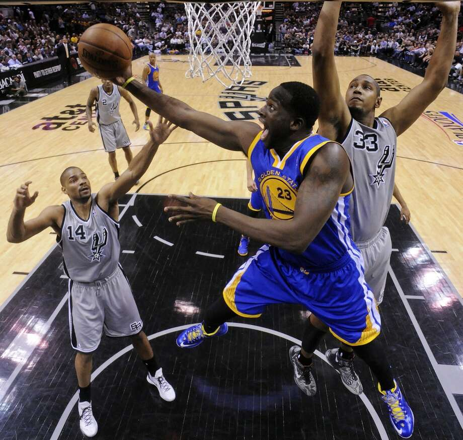 Golden State Warriors' Draymond Green shoots between San Antonio Spurs' Gary Neal and San Antonio Spurs' Boris Diaw in Game 1 of the NBA Western Conference semifinals Monday May 6, 2013 at the AT&T Center. The Spurs won 129-127 in double overtime.