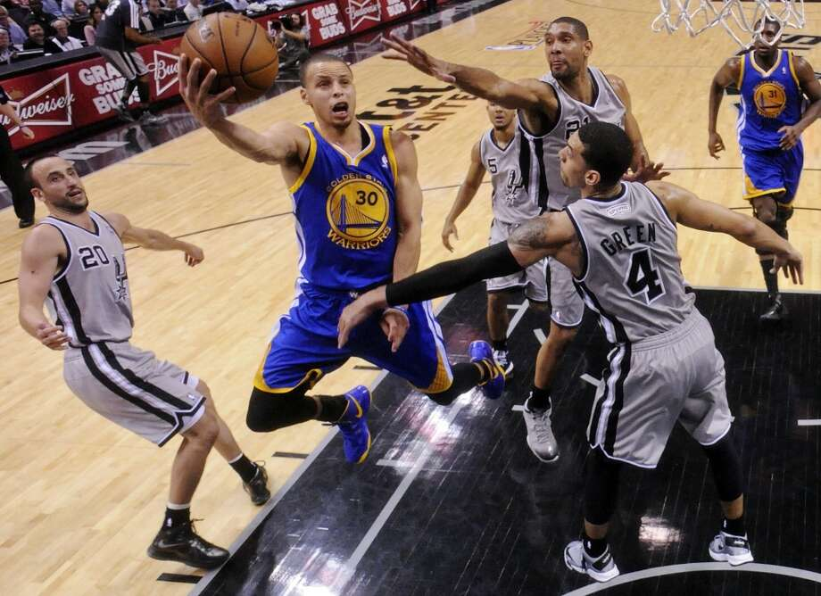 Golden State Warriors' Stephen Curry shoots between San Antonio Spurs' Manu Ginobili, San Antonio Spurs' Tim Duncan, and San Antonio Spurs' Danny Green in Game 1 of the NBA Western Conference semifinals Monday May 6, 2013 at the AT&T Center. The Spurs won 129-127 in double overtime.