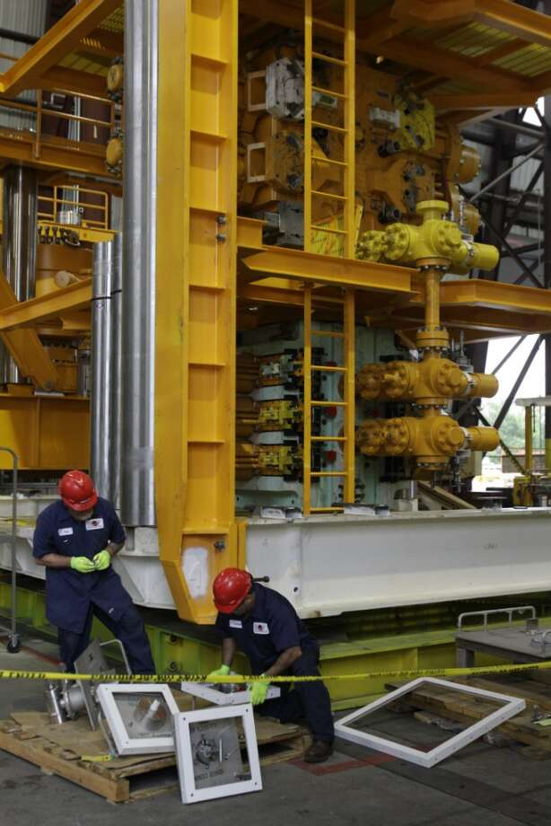 Employees at National Oilwell Varco. Photo: Melissa Phillip, Houston Chronicle