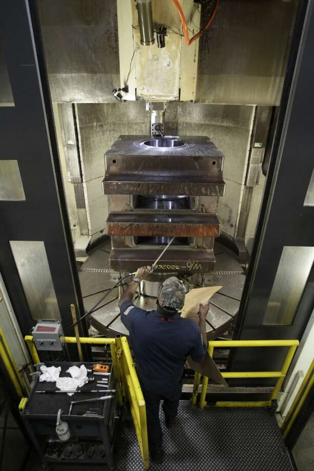Dale Johnson, a machinist at National Oilwell Varco, works on a part for a blowout preventer. Photo: Melissa Phillip, Houston Chronicle
