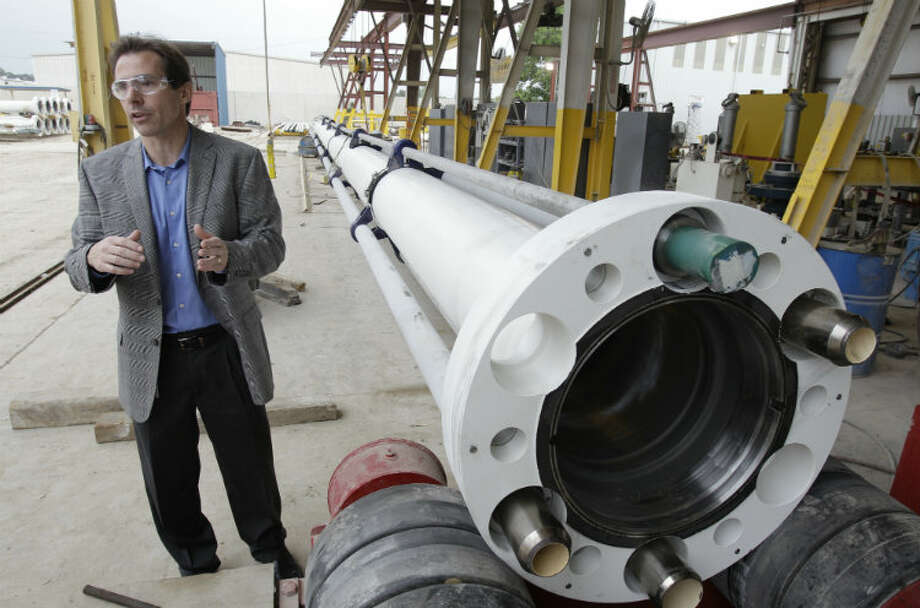Frank Springett, vice president of engineering of the pressure control group for National Oilwell Varco, talks about the riser joint that connects the blowout preventer subsea to the drilling rig. Photo: Melissa Phillip, Houston Chronicle