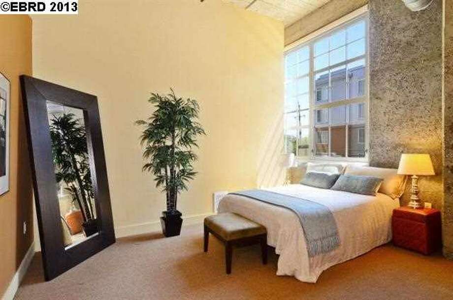 Bedroom with inevitable floor mirror. Photo via JULIA BIVINS, MCGUIRE REAL ESTATE/Redfin