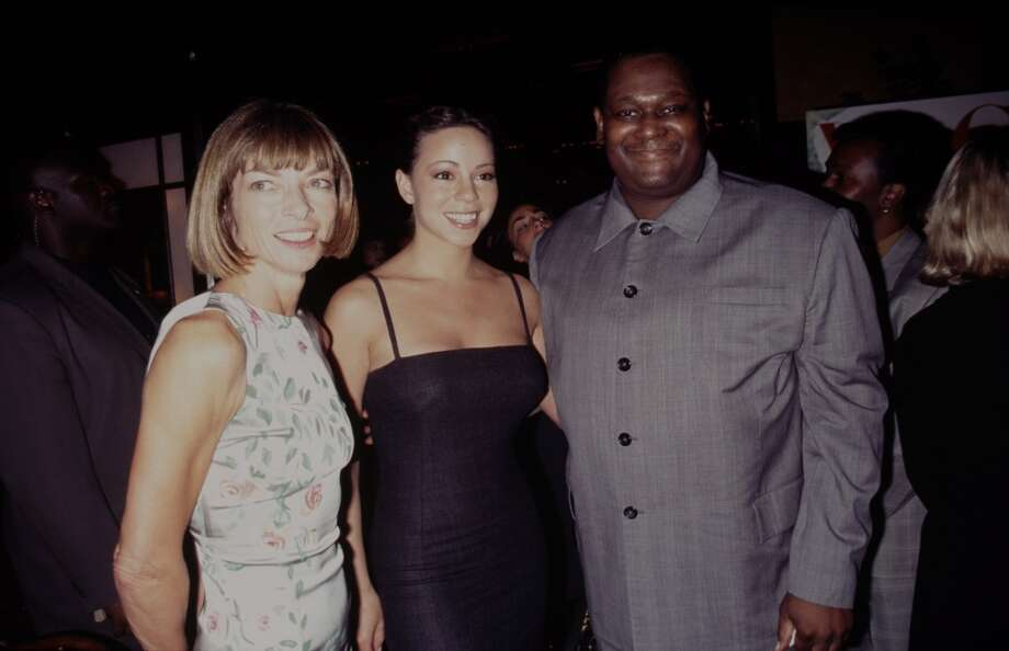 Mariah Carey (center) attends a Vogue magazine party in 1998 with Anna Wintour and Luther Vandross.