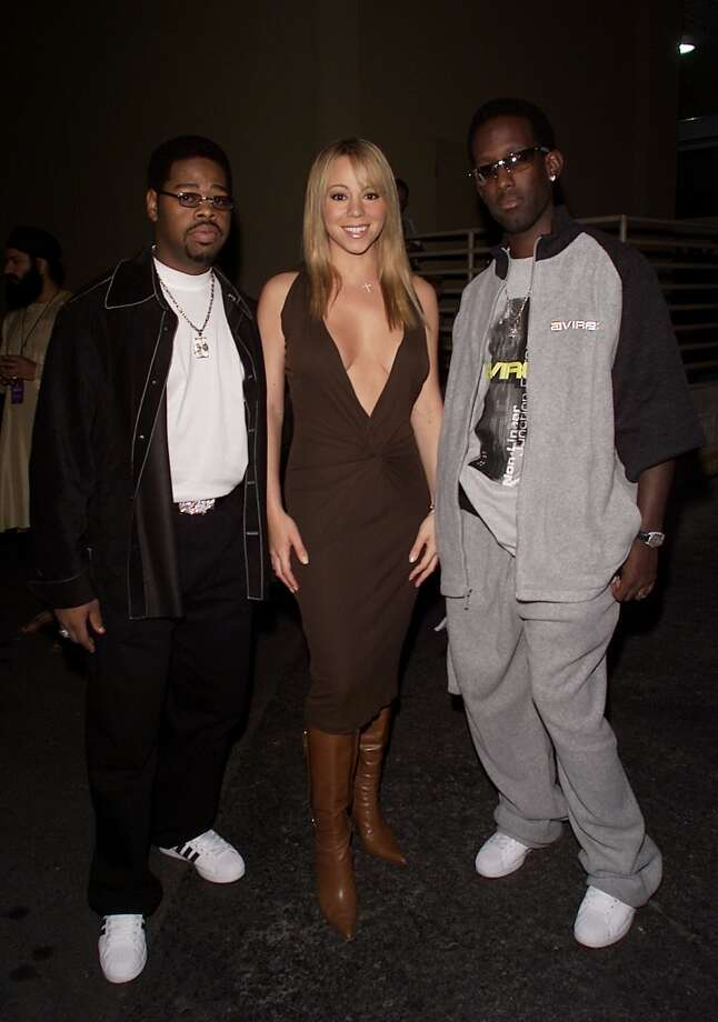 Mariah Carey joins Boyz II Men backstage at the 2001 Radio Music Awards in Las Vegas.