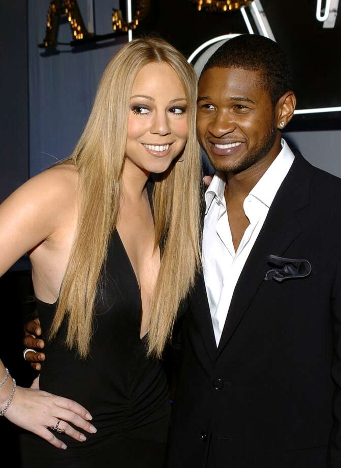 Mariah Carey gets cheek to cheek with Usher during 2005 ASCAP Pop Awards.