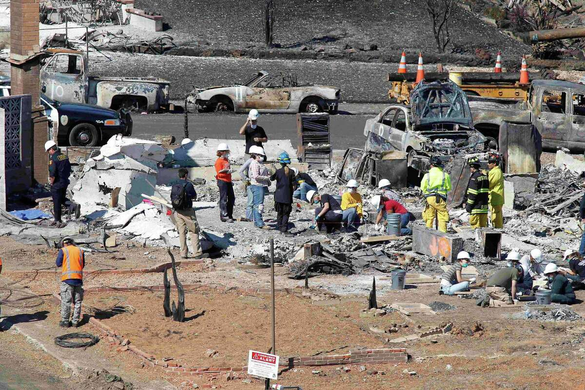 Emergency workers sifts through rubble of a burned down home, three days after a natural gas pipeline exploded into a deadly fireball in San Bruno, Calif., Sunday, Sept. 12, 2010. The remains of at least four people have been found, and authorities have said five people are missing. (AP Photo/Tony Avelar)