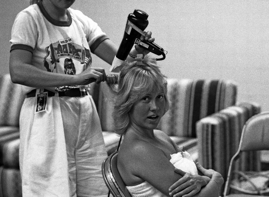 In the dressing room at the museum, you'll experience the feeling of the members having just entered the stage, and still smell the perfume in the room. (Pictured: Agnetha prepares for going on stage.)