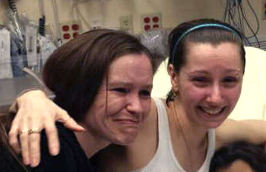 Amanda Berry, right, hugs her sister Beth Serrano after being reunited in a Cleveland hospital Monday May 6, 2013. Berry and two other women were found in a house near downtown Cleveland Monday after being missing for about a decade. Photo: Family Handout Courtesy WOIO-TV