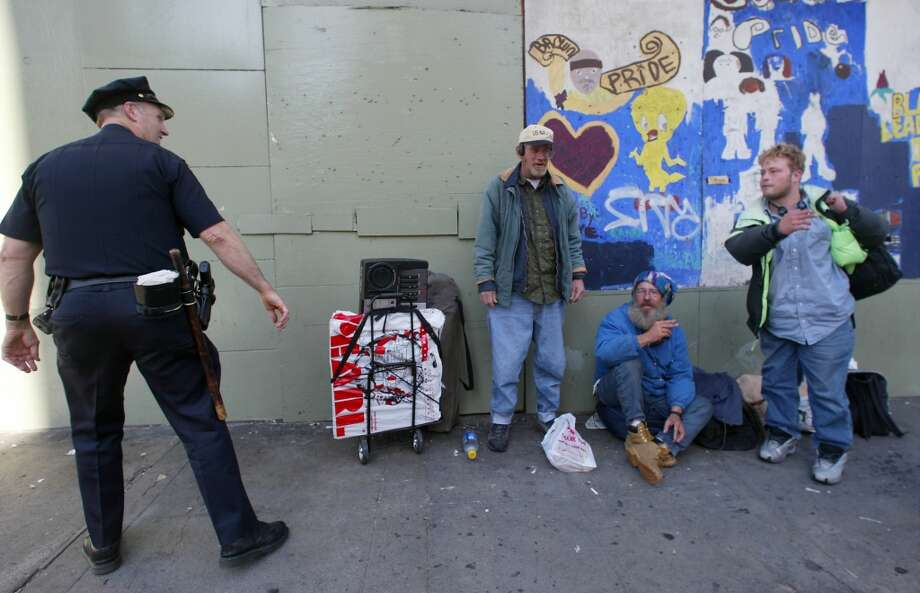 Everyone in the Tenderloin area knows Sergeant Joseph Garrity...he does a great job helping and reminding the homeless of city laws...here he talks wwith a group sitting to close to a school in Feb. 2006.