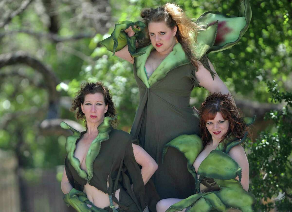 Belinda Harolds, left, Sara Brookes, top, and Morgan Clyde play the plant in the Vexler Theatre production of Little Shop of Horrors.