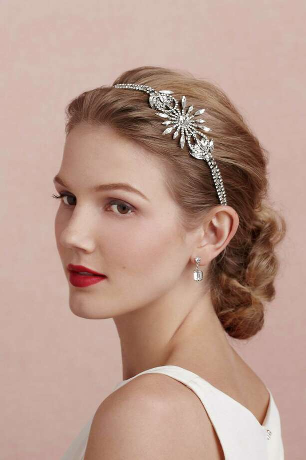 Hair raising: Twinkle at any party with a silver and Swarovski crystal hair ornament by Erickson Beamon; $420 at BHLDN. Photo: BHLDN