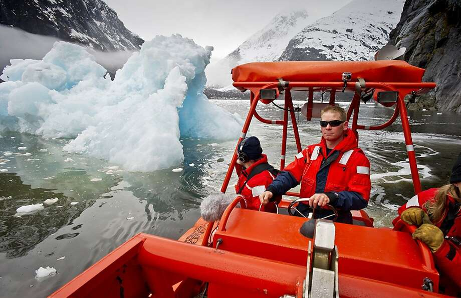 Dodging icebergs, Able-Bodied Seaman Noah Webb steers a rescue boat from the Alaska Marine Highway ferry Malaspina while surveying glaciers in Tracy Arm, Alaska. The ice from the twin Sawyer Glaciers was too thick for the Malaspina to make the full journey to the glacier faces. Photo: Michael Penn, Associated Press