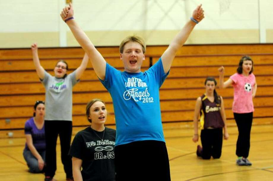 Christian Grugan, 18, center, with his helper Alex Meagher, 16, behind him, practices a cheer routine with The Angels on Thursday, May 2, 2013, at Sand Creek Middle School in Colonie, N.Y. The Capital District Challenger Cheer team will perform for the President's Council on Physical Fitness in Washington D.C. (Cindy Schultz / Times Union)
