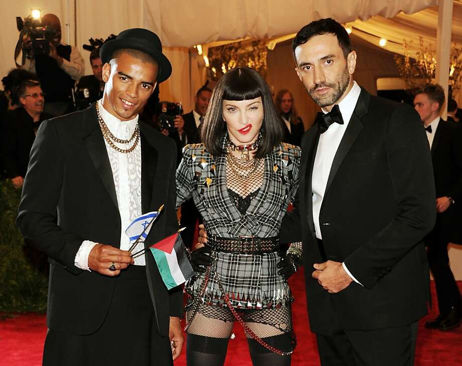 "Madonna forgets to put on pants for Met gala:  The 50-something diva does however sport a gray tartan jacket, torn fishnets and a facial tic for the Metropolitan Museum of Art's Costume Institute benefit celebrating ""PUNK: Chaos to Couture"" in New York. (With beau Brahim Zaibat [left] and designer Riccardo Tisci.) Photo: Evan Agostini, Associated Press"