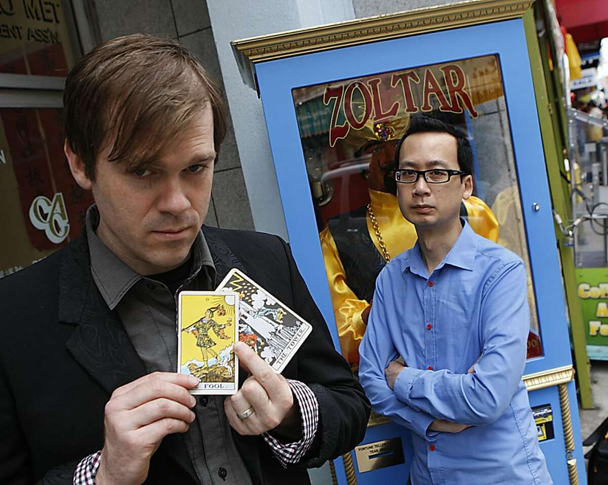 Brandon Patton (left) and Prince Gomolvilas (right) show where they found a Zoltar fortune telling machine in Chinatown in San Francisco, Calif., on Monday, May 6, 2013. They star in a new show at Berkeley's Impact Theatre called