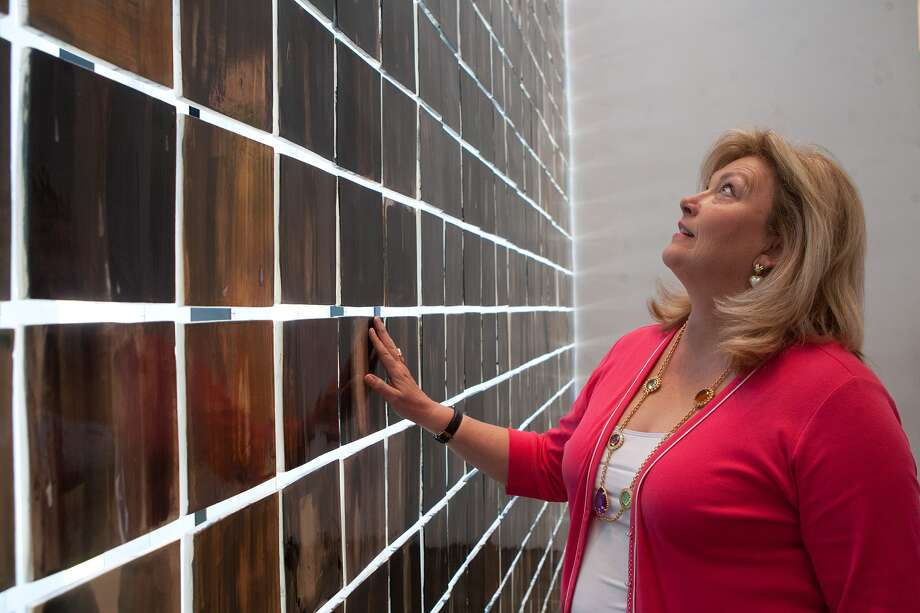 Before she recently retired as director of the Holocaust Museum Houston, Susan Myers worked to educate the public about the human toll of the Holocaust. Each square on the museum's Wall of Tears represents 10,000 victims. Photo: R. Clayton McKee, Freelance / © R. Clayton McKee