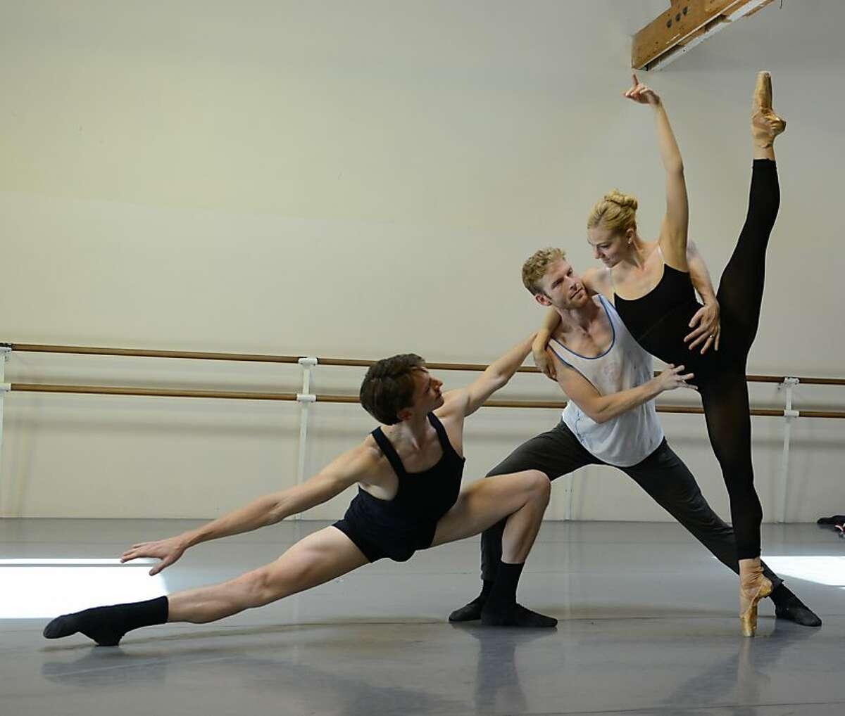 Smuin Ballet dancers Jonathan Dummar, Joshua Reynolds, and Erica Felsch rehearse