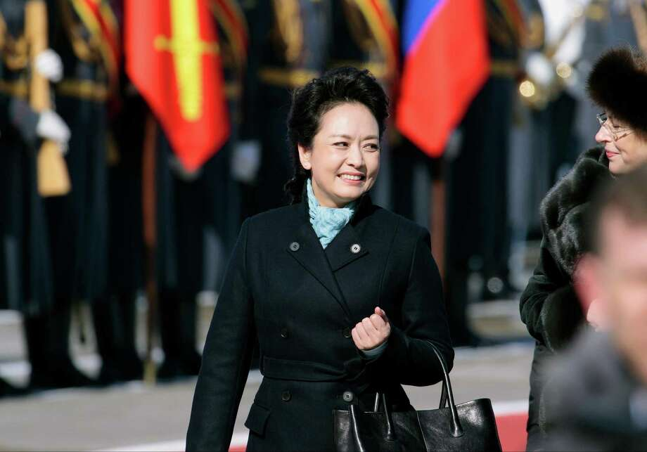"""43. Peng LiyuanChina's First Lady Peng Liyuan is a literal rock star.The second wife of China's President Xi Jinping """"is a renowned soprano singer in her homeland, even attaining the equivalent rank of major general as a 'artist-soldier' in China's army and is well-known for her charity work.""""Since becoming the first lady, Peng Liyuan has led trips to Russia and Africa to humanize the communist regime abroad. She is also a dynamic fashion icon, known for favoring local Chinese brands over Western fashion labels. Liyuan made TIME's 100 Most Influential People list this year. Photo: Ivan Sekretarev, File / AP"""