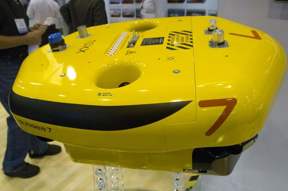 An, AIV, or Autonomous Inspection Vehicle made by Subsea 7, is seen at the company's booth during day two of the Offshore Technology Conference at Reliant Center Tuesday, May 7, 2013, in Houston. The vehicle is used to conduct inspections at on subsea systems at depths of up to 10,000 feet. (Cody Duty / Houston Chronicle) Photo: Cody Duty, Houston Chronicle