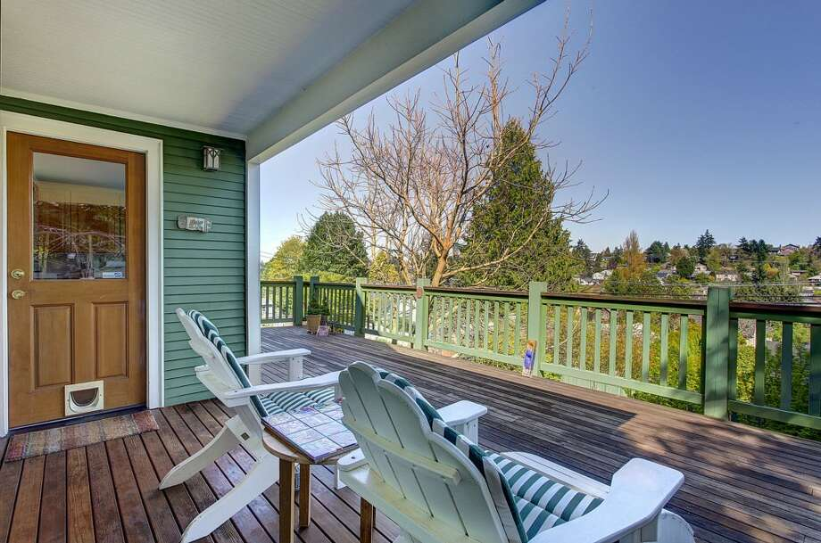 Back deck of 3622 36th Ave. W. The 2,020-square-foot Craftsman, built in 1908, has two bedrooms, 1.5 bathrooms, French doors, a front porch and unique outdoor metal art on a 6,000-square-foot lot. It's listed for $549,900. Photo: HD Estates, Courtesy Marcus Holmes, WaLaw Realty