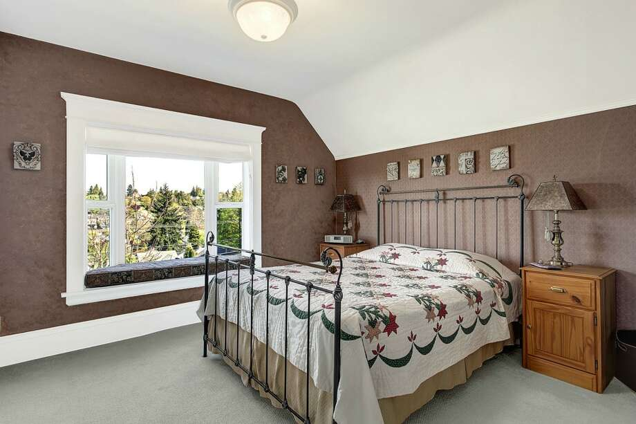 Bedroom of 3622 36th Ave. W. The 2,020-square-foot Craftsman, built in 1908, has two bedrooms, 1.5 bathrooms, French doors, a front porch, a back deck and unique outdoor metal art on a 6,000-square-foot lot. It's listed for $549,900. Photo: HD Estates, Courtesy Marcus Holmes, WaLaw Realty