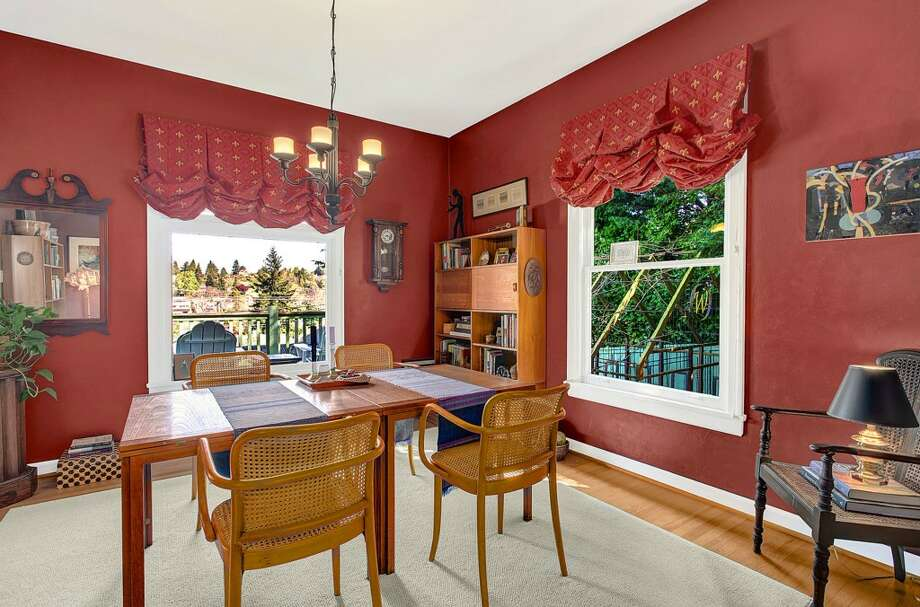 Dining room of 3622 36th Ave. W. The 2,020-square-foot Craftsman, built in 1908, has two bedrooms, 1.5 bathrooms, French doors, a front porch, a back deck and unique outdoor metal art on a 6,000-square-foot lot. It's listed for $549,900. Photo: HD Estates, Courtesy Marcus Holmes, WaLaw Realty