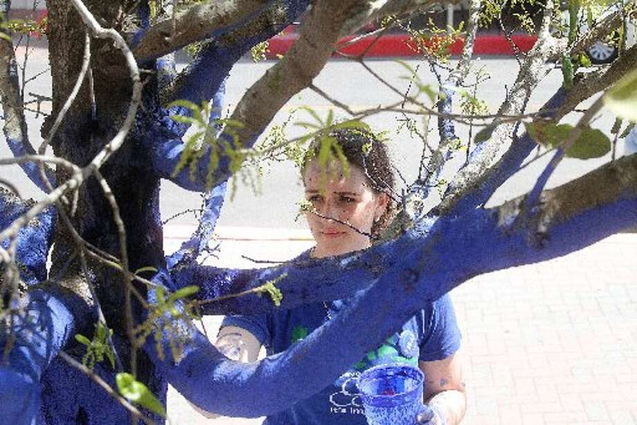 "India Coleman of the Galveston Arts Center paints trees in Saengerfest Park as part of ""The Blue Trees"" art installation to promote conversation about deforestation. On May 2, the center on its Facebook page encouraged people to grab their friends for a Blue Trees photo shoot and then share those photos with the center to be featured in a cover photo collage.    India Coleman of the Galveston Arts Center paints trees in Saengerfest Park as part of ""The Blue Trees"" art installation to promote conversation about deforestation. On May 2, the center on its Facebook page encouraged people to grab their friends for a Blue Trees photo shoot and then share those photos with the center to be featured in a cover photo collage."