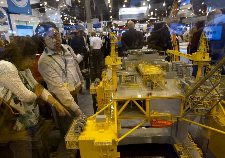 Attendees look at a model of an oil well platform during day two of the Offshore Technology Conference at Reliant Center Tuesday, May 7, 2013, in Houston. (Cody Duty / Houston Chronicle) Photo: Cody Duty, Houston Chronicle
