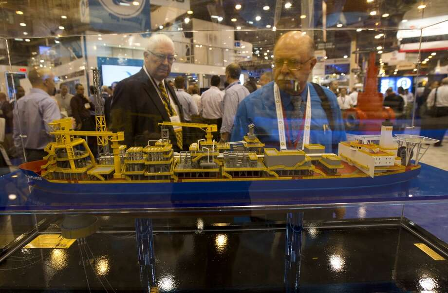 Attendees look at a Deepwater FPSO during day two of the Offshore Technology Conference at Reliant Center Tuesday, May 7, 2013, in Houston. (Cody Duty / Houston Chronicle) Photo: Cody Duty, Houston Chronicle