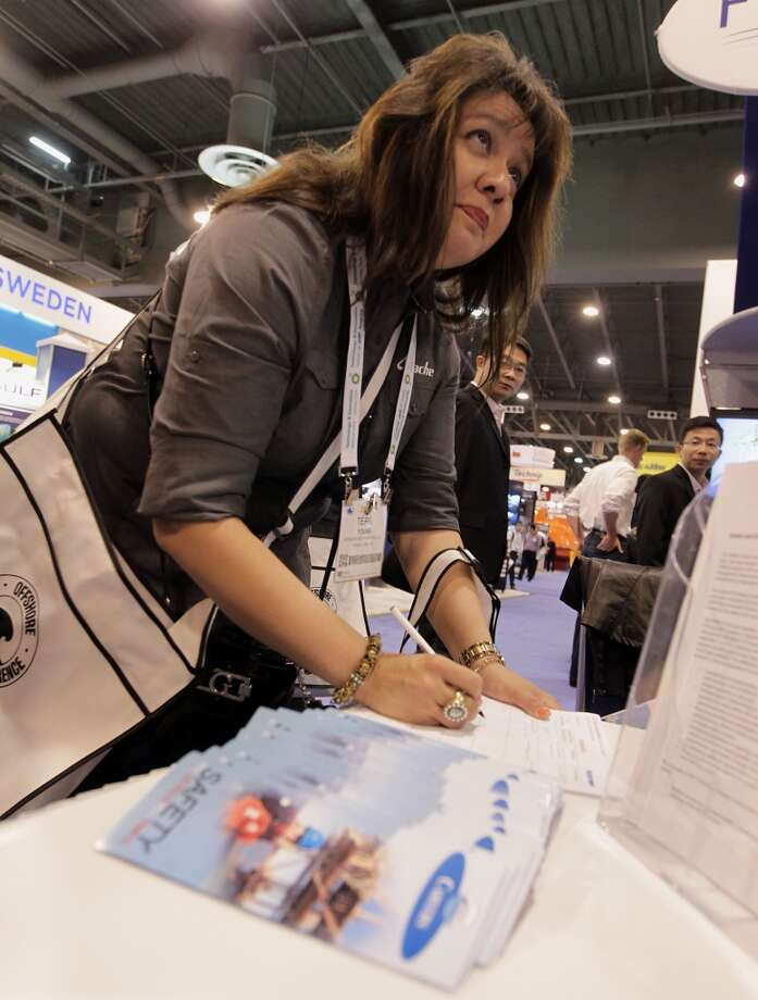 Apache Deepwater's Terri Young signs up for information at the Bureau of Safety and Environmental Enforcement booth during OTC 2013 at Reliant Park Tuesday, May 7, 2013, in Houston. ( James Nielsen / Houston Chronicle ) Photo: James Nielsen, Houston Chronicle