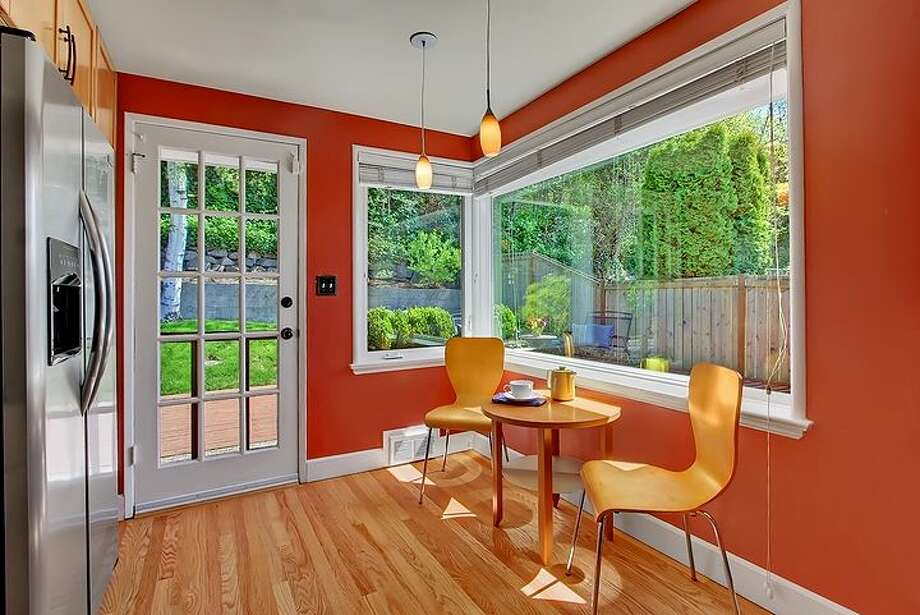 Breakfast nook of 3516 31st Ave. W. The 1,860-square-foot mid-century modern home, built in 1951, has three bedrooms, 1.75 bathrooms, an updated kitchen, a family room with a fireplace and a big deck on a 5,880-square-foot lot. It's listed for $558,888. Photo: Courtesy Bruce Phares And Mark Besta, Windermere Real Estate