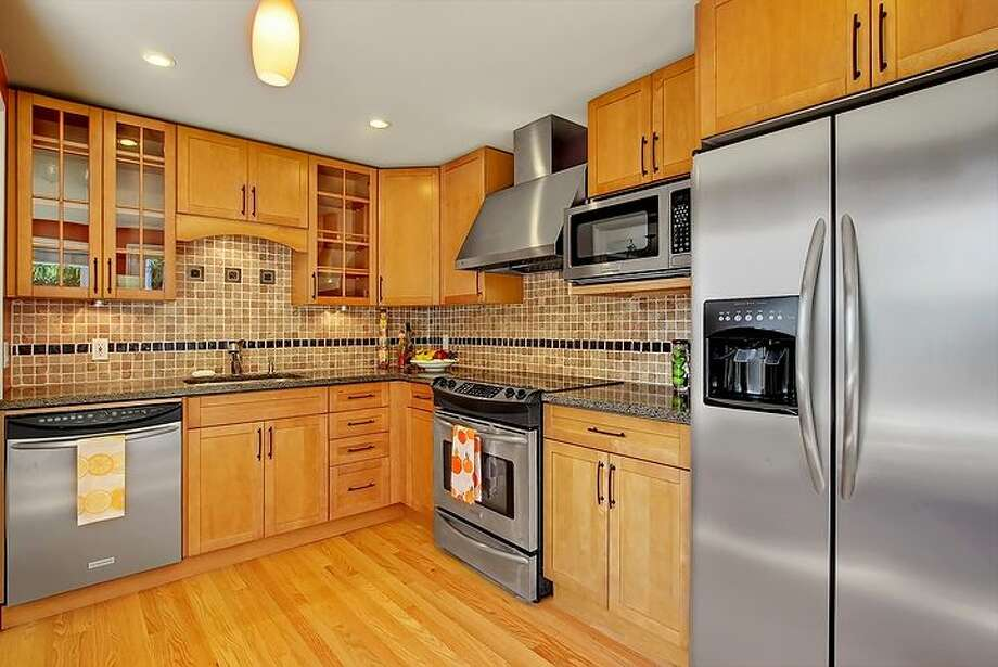Kitchen of 3516 31st Ave. W. The 1,860-square-foot mid-century modern home, built in 1951, has three bedrooms, 1.75 bathrooms, a family room with a fireplace and a big deck on a 5,880-square-foot lot. It's listed for $558,888. Photo: Courtesy Bruce Phares And Mark Besta, Windermere Real Estate