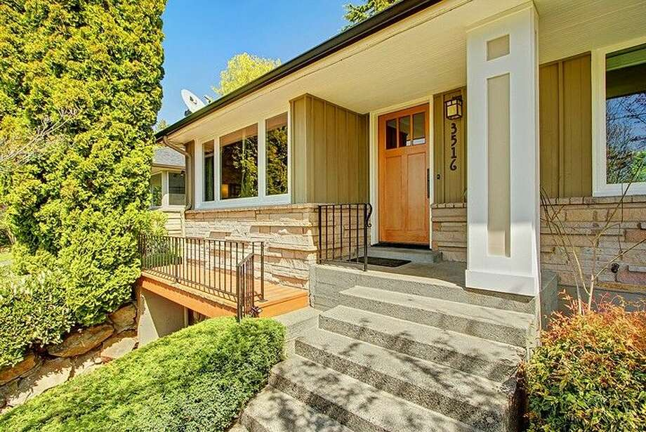 Moving up in price to $558,888 and year to 1951, here's 3516 31st Ave. W. The 1,860-square-foot mid-century modern home has three bedrooms, 1.75 bathrooms, an updated kitchen, a family room with a fireplace and a big deck on a 5,880-square-foot lot. Photo: Courtesy Bruce Phares And Mark Besta, Windermere Real Estate