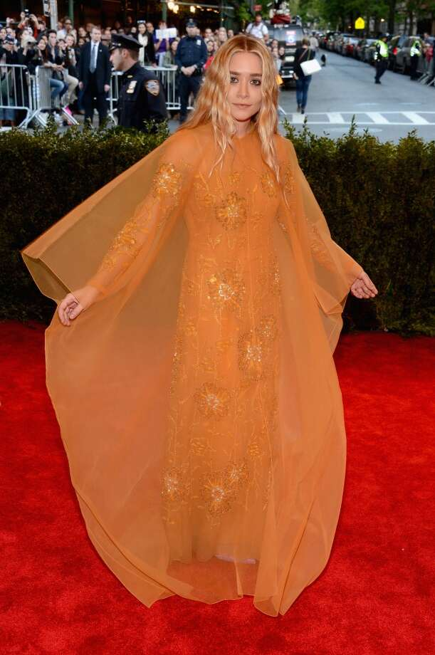 Bad: Mary-Kate & Ashley Olsen. Between Ashley's orange net tent (seen here) and Mary-Kate's oversized robe, it's hard to tell what either sister is actually wearing, but from what we can see, neither look is very punk
