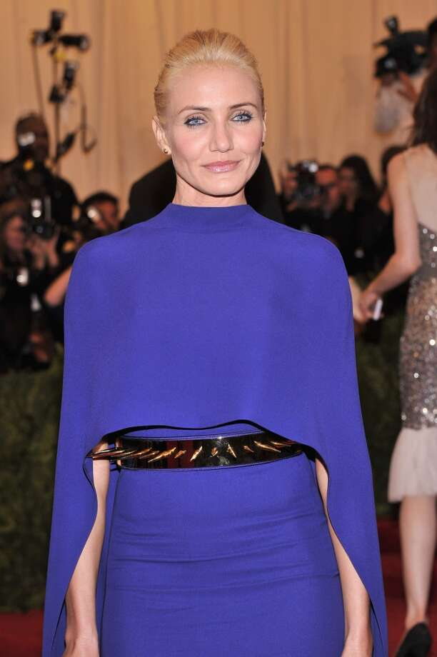 Bad: Cameron Diaz. The bold color suits her, but the dress' fit and cape, coupled with the severe hair, aren't flattering. And watch out for that belt. Ouch.