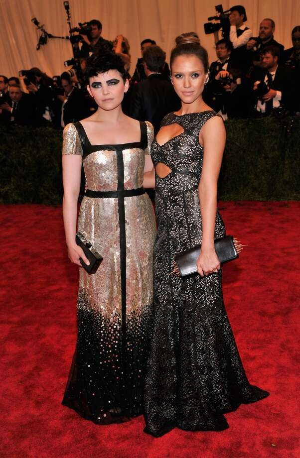Bad and Good: Ginnifer Goodwin and Jessica Alba. Goodwin's eye-makeup and shapeless dress are a miss, while Alba is looking elegant and event-appropriate with her cutout dress.