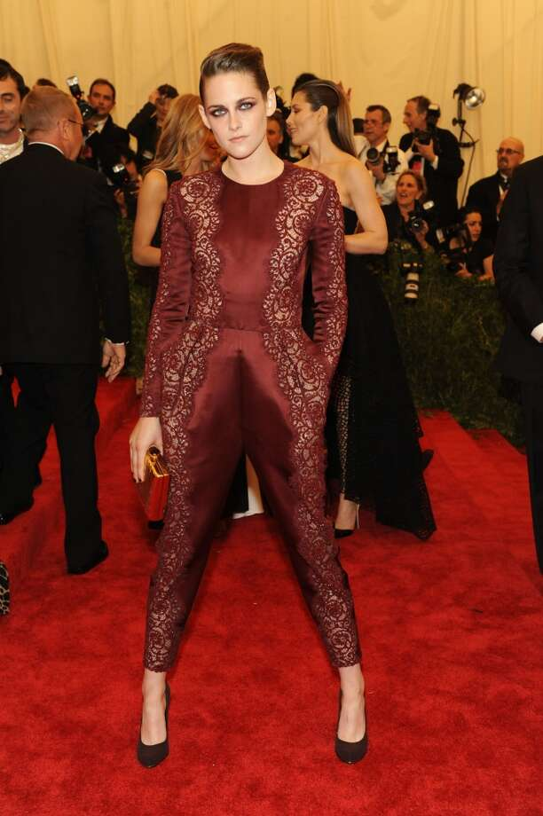Bad: Kristen Stewart. The color of her jumpsuit is striking and we admire her chutzpah for donning it, but the fit isn't flattering and the red eye makeup only makes her look more sullen.