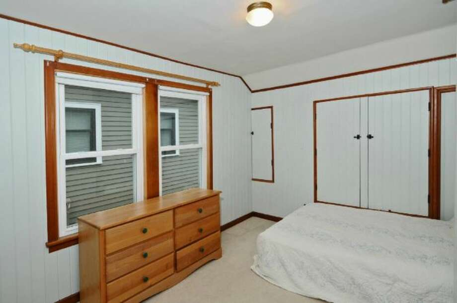 Bedroom of 2644 W. Boston St. The 2,260-square-foot home, built in 1926, has three bedrooms, two bathrooms, a family room, a deck, and views of downtown Seattle and Puget Sound on a 4,000-square-foot lot. It's listed for $579,000, although a sale is pending. Photo: Courtesy James Goodman/Windermere Real Estate