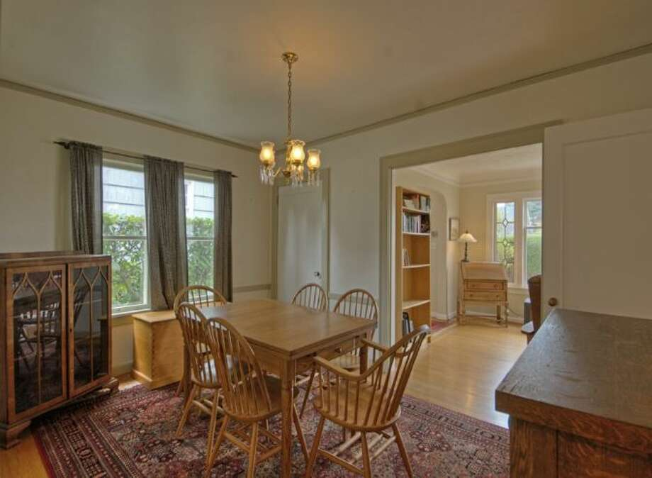 Dining room of 2644 W. Boston St. The 2,260-square-foot home, built in 1926, has three bedrooms, two bathrooms, a family room, a deck, and views of downtown Seattle and Puget Sound on a 4,000-square-foot lot. It's listed for $579,000, although a sale is pending. Photo: Courtesy James Goodman/Windermere Real Estate