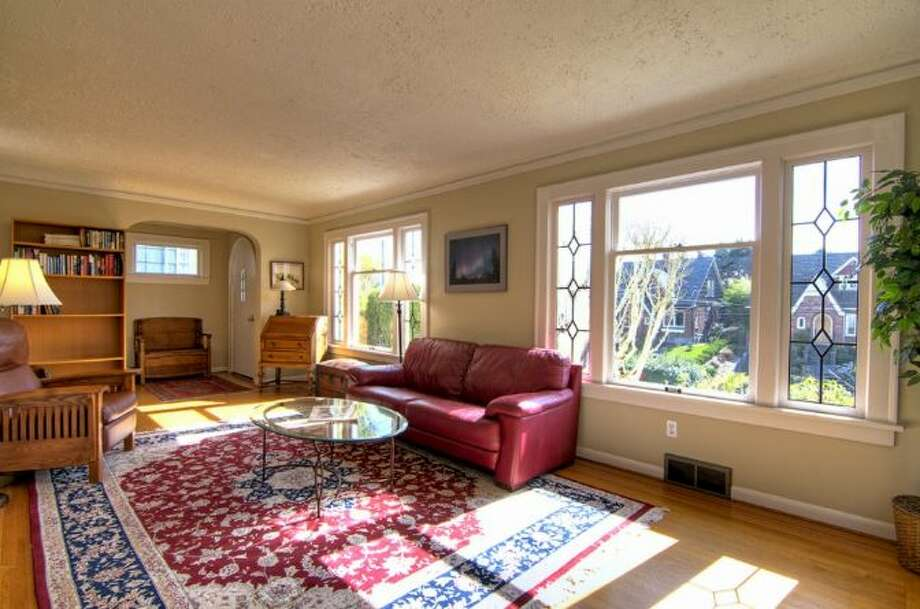 Living room of 2644 W. Boston St. The 2,260-square-foot home, built in 1926, has three bedrooms, two bathrooms, a family room, a deck, and views of downtown Seattle and Puget Sound on a 4,000-square-foot lot. It's listed for $579,000, although a sale is pending. Photo: Courtesy James Goodman/Windermere Real Estate