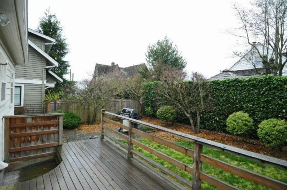 Deck of 2644 W. Boston St. The 2,260-square-foot home, built in 1926, has three bedrooms, two bathrooms, a family room and views of downtown Seattle and Puget Sound on a 4,000-square-foot lot. It's listed for $579,000, although a sale is pending. Photo: Courtesy James Goodman/Windermere Real Estate