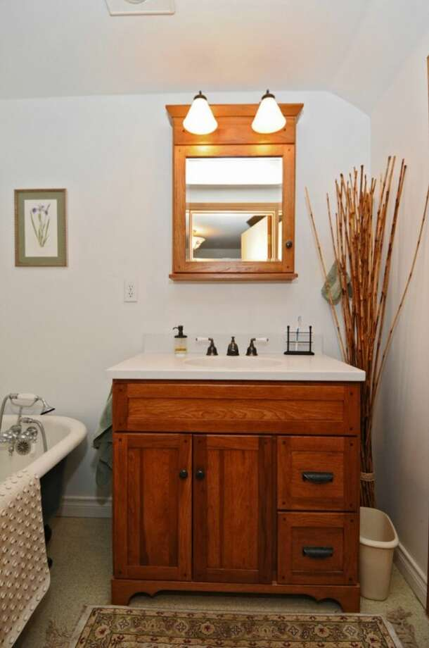 Bathroom of 2644 W. Boston St. The 2,260-square-foot home, built in 1926, has three bedrooms, two bathrooms, a family room, a deck, and views of downtown Seattle and Puget Sound on a 4,000-square-foot lot. It's listed for $579,000, although a sale is pending. Photo: Courtesy James Goodman/Windermere Real Estate