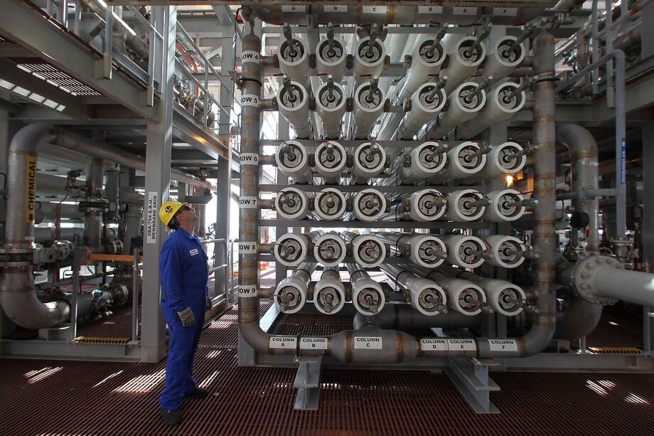 David Hernandez, Operations Manager for Ursa TLP  Shell Exploration & Production Company looks over some of the seawater filters which are part of the water injection system on the Shell Ursa TLP (tension leg platform) located in the Mississippi Canyon block 809 in Gulf of Mexico Wednesday, Oct. 17, 2012, in New Orleans. Water injection is used to increase the pressure inside the reservoir to increase oil recovery. ( James Nielsen / Chronicle ) Photo: Chronicle