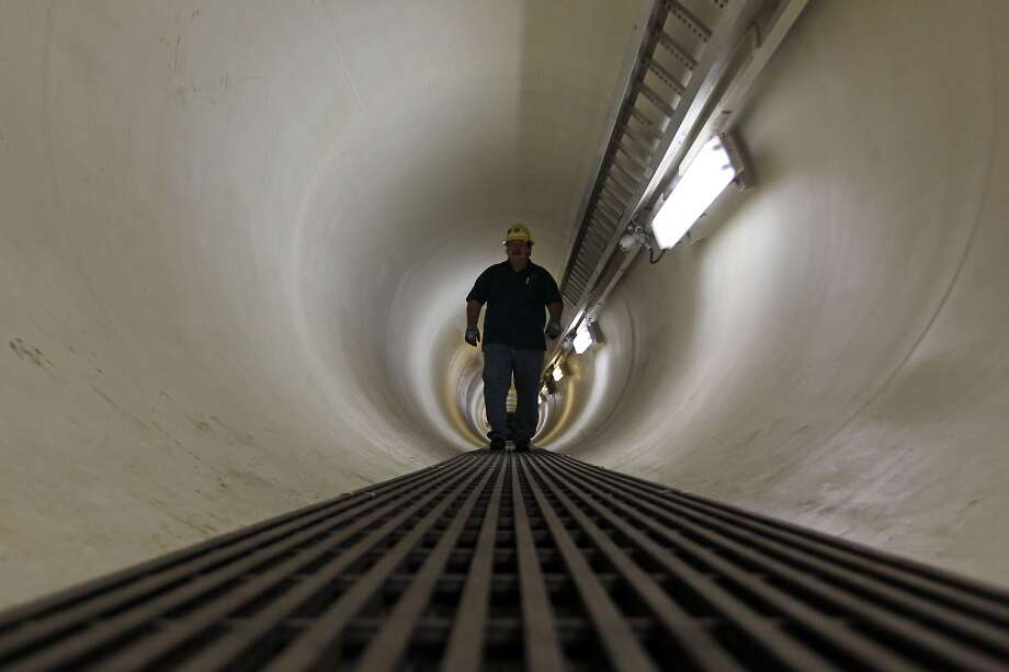 Shell's Richard Crabtree walks in a tunnel in approximately 98 feet underwater which connects the four circular steel columns which are 85 feet in diameter, 177 feet high, on the Shell Ursa TLP (tension leg platform) located in the Mississippi Canyon block 809 in Gulf of Mexico Wednesday, Oct. 17, 2012, in New Orleans. ( James Nielsen / Chronicle ) Photo: Chronicle