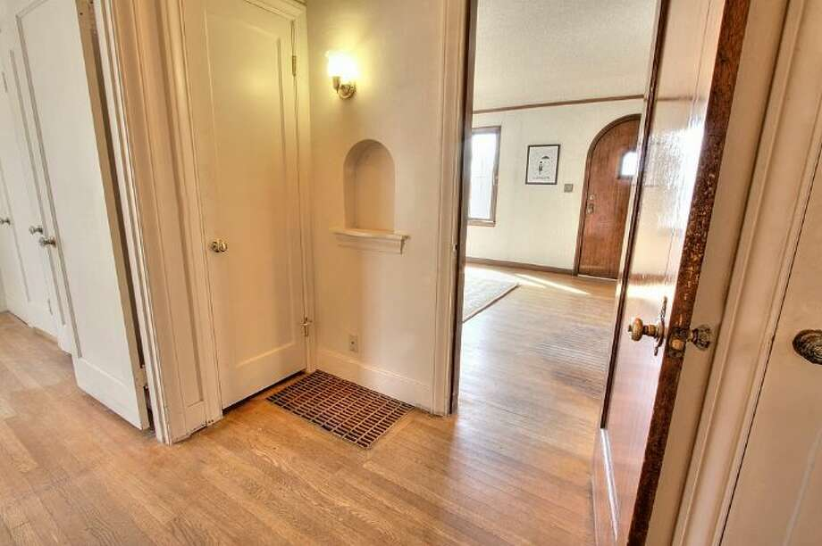 Hallway of 2834 29th Ave. W. The 2,050-square-foot Tudor, built in 1930, has four bedrooms, 1.5 bathrooms, coved ceilings, leaded glass, a family room, a deck and sound views on a 6,000-square-foot lot. It's listed for $599,900, although a sale is pending. Photo: Courtesy Liz Talley, Windermere Real Estate