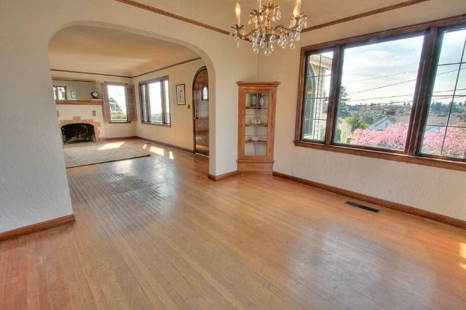 Dining room of 2834 29th Ave. W. The 2,050-square-foot Tudor, built in 1930, has four bedrooms, 1.5 bathrooms, coved ceilings, leaded glass, a family room, a deck and sound views on a 6,000-square-foot lot. It's listed for $599,900, although a sale is pending. Photo: Courtesy Liz Talley, Windermere Real Estate