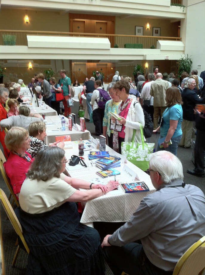 600 writers and fans of traditional mysteries - including a sizeable Connecticut contingent - attended the Malice Domestic conference in Bethesda, MD last weekend. The signing area was packed throughout the weeked with readers and dozens of authors. Photo: Contributed Photo