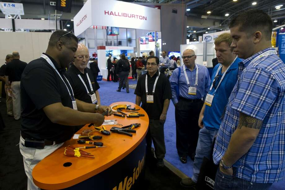 Attendees watch a wire-cutting display from Weidmüller during day two of the Offshore Technology Conference at Reliant Center Tuesday, May 7, 2013, in Houston. (Cody Duty / Houston Chronicle) Photo: Cody Duty, Houston Chronicle