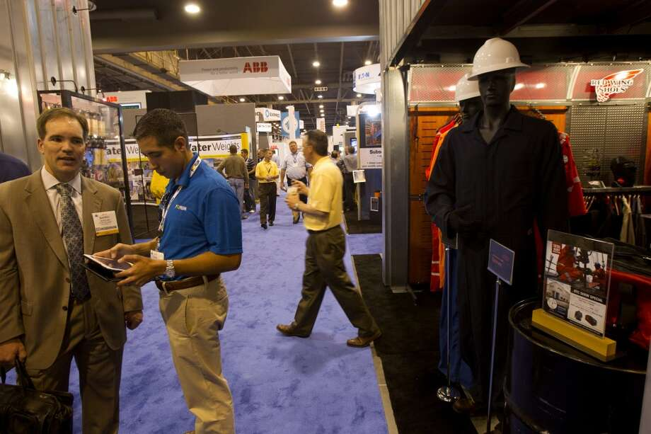 Protective gear is seen as attendees make their way through day two of the Offshore Technology Conference at Reliant Center Tuesday, May 7, 2013, in Houston. (Cody Duty / Houston Chronicle) Photo: Cody Duty, Houston Chronicle
